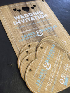 Wooden invitations printed with hearts cutouts