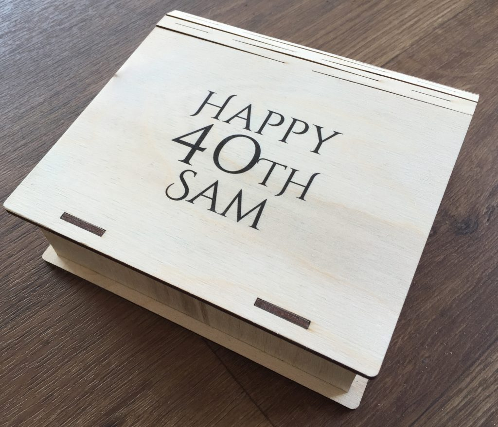Wooden box printed with text