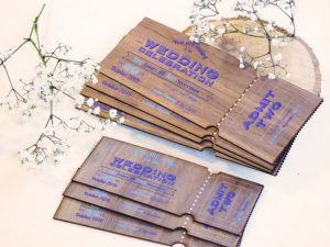 Ticket style wooden wedding invitations and save the dates