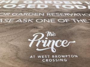 The Prince london printed on wood