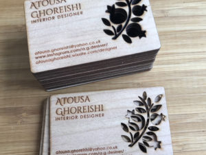 Engraved wooden business card on cherry