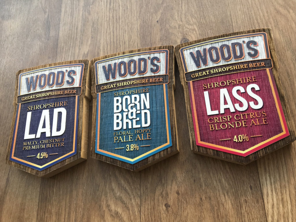 Woods Beer badges