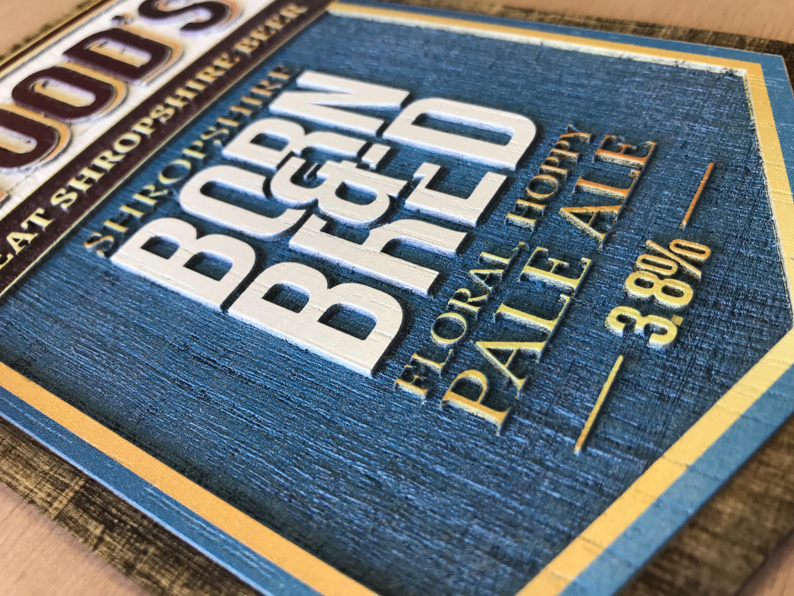 Woods Solid Oak beer pump badge