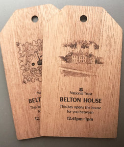 belton House national trust key fobs on wood