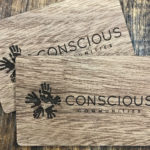Engraved wooden business card on wood