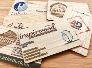 assortment of printed wooden business cards