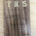 printed and varnished wooden business card on americal walnut wood